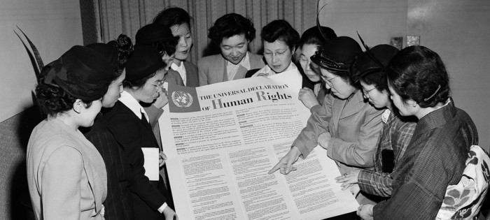 UN Photo A group of Japanese women look at the Universal Declaration of Human Rights during a visit to the UN's interim headquarters in Lake Success in February 1950